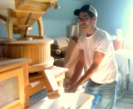 Dave Bauer making stone ground flour