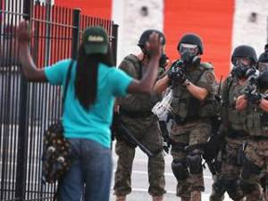 Ferguson police aim at protestor