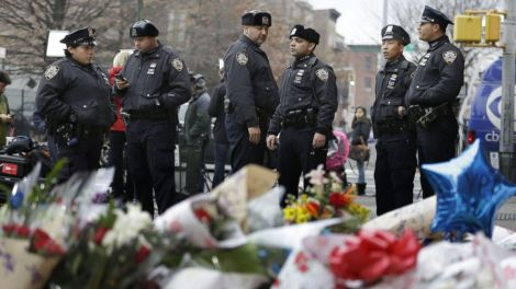 NYPD officers at memorial